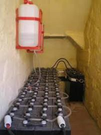 Large battery bank with automatic waterer